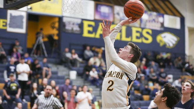 Stayton junior Cade Nau (2) goes up for a basket against Newport at Stayton High School on Tuesday, Jan. 19, 2016. The Stayton Eagles lost 38-51 to the Newport Cubs.