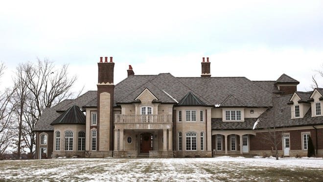 This custom home was built in 2002 and sits on a private all-sports lake, Lake Shinanguag, in Goodrich. It has more than 20,000 square feet.