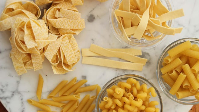 This photo shows an array of dried pastas for making easy weeknight pasta dinners. Clockwise from top, egg noodles, ziti, cavatappi , penne and pappardelle. ,