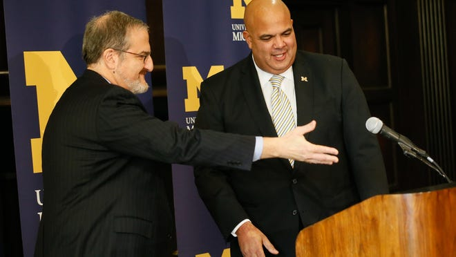 U-M President Mark Schlissel, left, introduces Warde Manuel as his new athletic director Friday in Ann Arbor. Schlissel didn't know Manuel, unlike many in the athletic department, but made the decision to hire him.