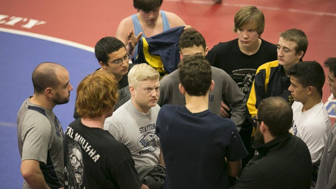 Stayton wrestling coach Stuart Peterson speaks to his team before round two matches at West Albany High School in Albany on Saturday, Feb. 6, 2016.