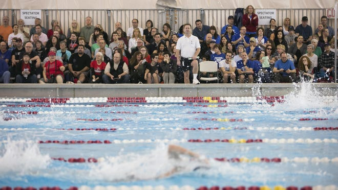 Spectators watch the OSAA Swimming State Championships at Mount Hood Community College on Friday, Feb. 19, 2016.