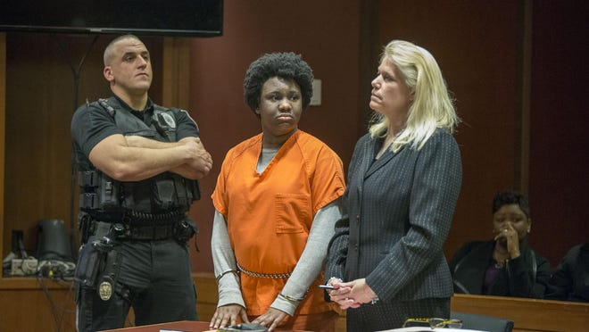 With her mother Juana Sully seated behind her, Hyphernkemberly Dorvilier stands between a sheriff's deputy and her defense attorney Karen Thek as she listens to the charges against her. Dorvilier pleaded guilty Monday to aggravated manslaughter. Authorities say she doused her newborn with accelerant and set her on fire in January 2015.