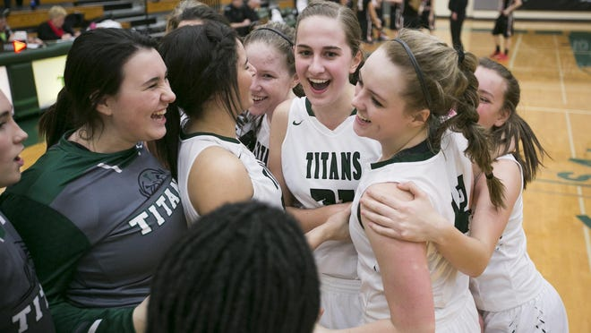 West Salem players celebrate after defeating North Medford 58-55 in overtime at West Salem High School on Tuesday, March 1, 2016.