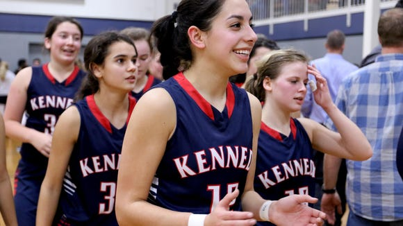 Kennedy's Lakin Susee (12) smiles and walks off the court following the Kennedy vs. Western Mennonite girl's basketball game at Western Mennonite High School in Salem on Wednesday, Dec. 16, 2015. Kennedy won the game 44-41.