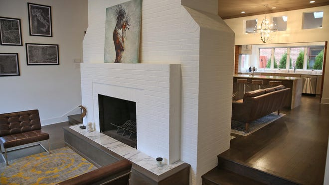 The open front living area is separated from the kitchen with back-to-back fireplaces, at 501 Lockerbie St., Thursday, March 10, 2016.