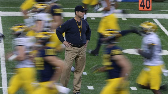 """In public, Jim Harbaugh has not looked ahead. But in private, he has told the Wolverines they have potential. """"It's up to us whether we're going to take the coaching and where we want to take it,"""" guard Kyle Kalis said."""