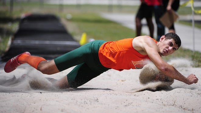 Dunbar's Rudy Alvarez competes in the boys triple jump during the 2A-12 district track and field final Friday, April 22, 2016 at Lely High School in Naples, Fla. Teams from Collier, Lee and Hendry counties came to compete to advance to regionals. (Corey Perrine/Staff)