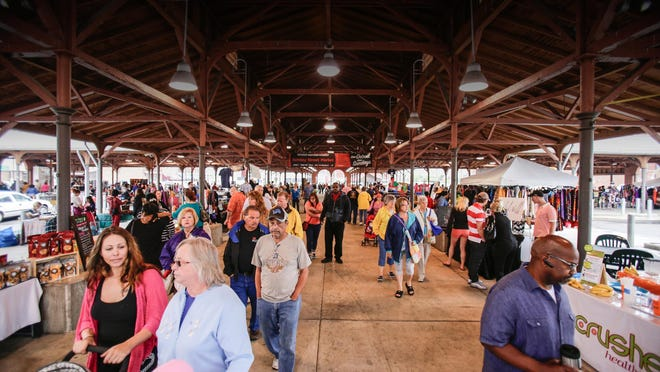 Hundreds of people visit Eastern Market's Shed 4 each weekend. Now an open-air facility, it would become an enclosed market hall with up to 60 mixed-income residences built atop it. The Shed 4 project could cost $10 million to $15 million.