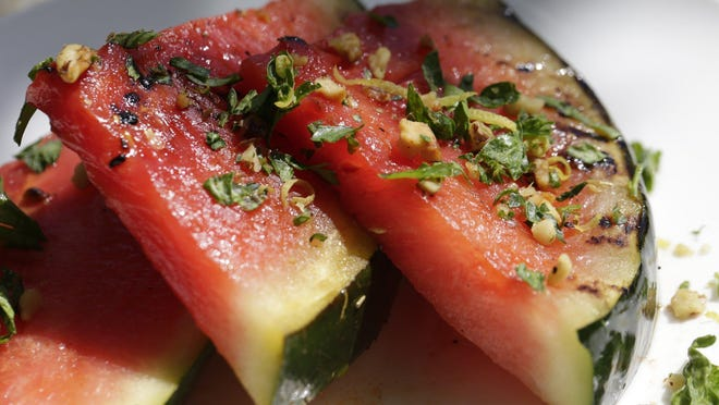 Grilling concentrates the watermelon flavor. Sprinkle with finely chopped parsley, lemon peel and walnuts.