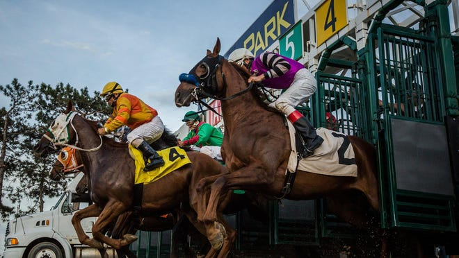 Horses bolt from the starting gate during the 2016 opening day at Hazel Park Raceway last Friday. The racing industry hopes new bills in the Legislature will end years of financial decline.
