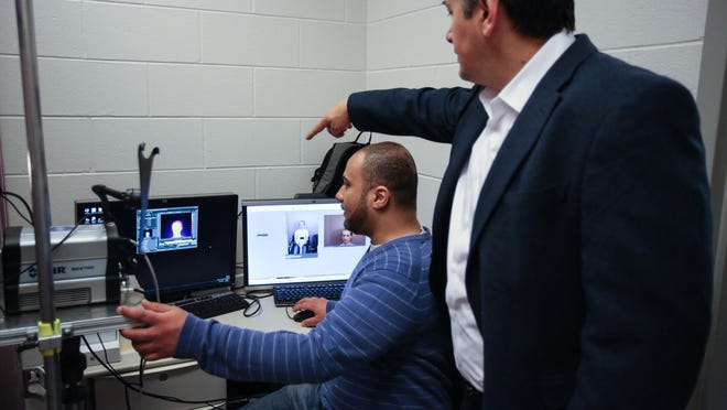 Post-doctorate researcher Mohamed Abouelenien and Mihai Burzo, assistant professor of mechanical engineering at University of Michigan-Flint, demonstrate a unique lie-detecting software based on real-world data from volunteers and video from court cases.