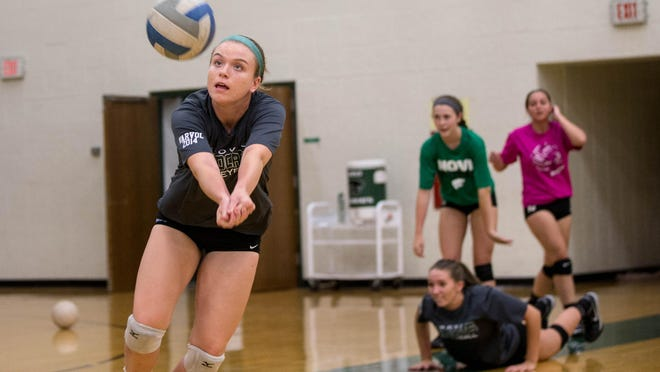 Novi junior setter Erin O'Leary participates in drills during volleyball tryouts Wednesday. The Wildcats won the Class A state title last year, defeating Romeo in the final.