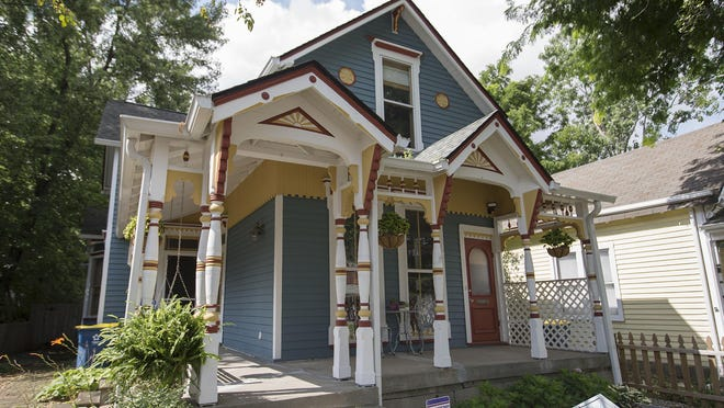 Rob and Erin Till repainted the exterior of their 1,889-square-foot home in the Cottage Home neighborhood.