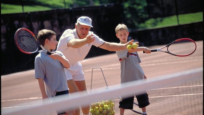 Tennis pro Perk Larsen works with kids on their game at Mohonk Mountain House.