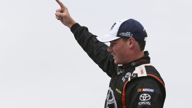 Aug 27, 2016; Brooklyn, MI, USA; NASCAR Camping World Truck Series driver Brett Moffitt (11) reacts to winning the Careers for Veterans 200 at Michigan International Speedway. Mandatory Credit: Aaron Doster-USA TODAY Sports