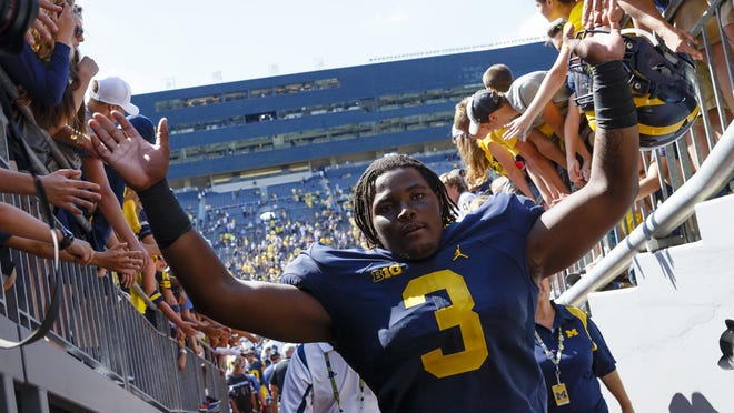 Michigan defensive lineman Rashan Gary greets the crowd while leaving the field after Saturday's 63-3 win over Hawaii at Michigan Stadium. Gary, a true freshman and the top recruit in the 2016 class, had three tackles and could see an increased role this Saturday against Central Florida.
