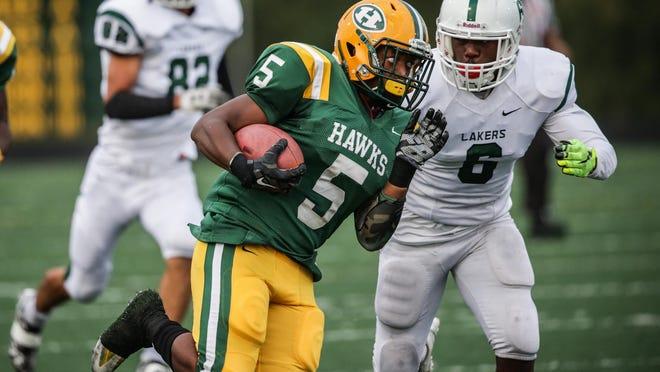 Farmington Hills Harrison's Guam Lee Jr. runs the ball during the win over West Bloomfield on Friday in Farmington Hills.