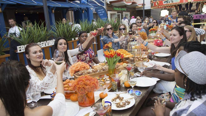 Guests raise a toast during a Friendsgiving celebration for cruise passengers on Royal Caribbean's ship Harmony of the Seas two weeks before Thanksgiving this year.