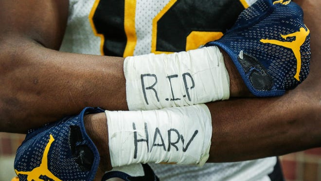"""Jesse Scarber shows his taped wrists with """"R.I.P Harv"""" for King coach Dale Harvel, who passed away before the season."""