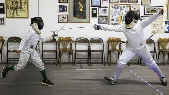 Justin Gonzalez (left) of Salem bouts with Ian Clingerman of Keizer at the Salem Fencing Club in March of 2015.