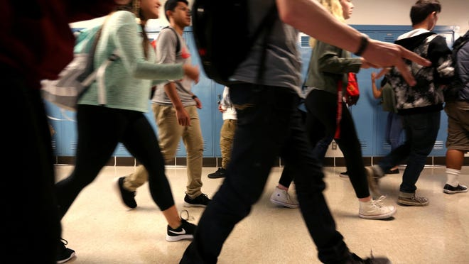 Students at McNary High School in Keizer walk in a crowded hallway.