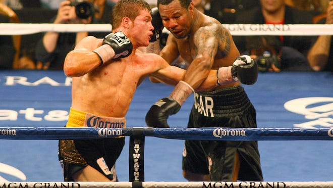 Canelo Alvarez, left, and Shane Mosley fight during their bout in 2012 in Las Vegas. (Photo: Jake Roth, USA TODAY Sports)