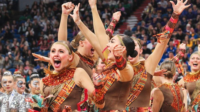The Sartell Sabres celebrate their the state Class 2A high kick title Saturday, Feb. 18, at the Target Center in Minneapolis.