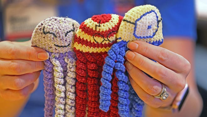 "Riley Hospital for Children neuro-diagnostic specialists Tina Miller and Celeste Merz have started the initiative to crochet 700 ""jellyfish"" for NICU babies, in memory of the popular neurologist Dr. Mandy Harris, who died in 2017, at the age of 41. The small jellyfish, like these, are made for the tiniest of patients, giving them something other than tubes to grab onto, resembling the umbilical cord."