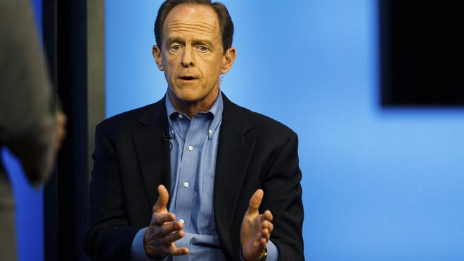 Sen. Pat Toomey takes part in a TV town hall in the Harrisburg, Pa., studios of WHTM-TV, Wednesday, July 5, 2017. (James Robinson /PennLive.com via AP)