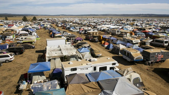 Thousands of tents, RVs and other shelters in the dusty landscape at the Symbiosis eclipse festival east of Prineville at Big Summit Prairie on Sunday, Aug. 20, 2017. The week-long festival drew people from all over the world for a mix of arts, music, dance and total solar eclipse viewing.