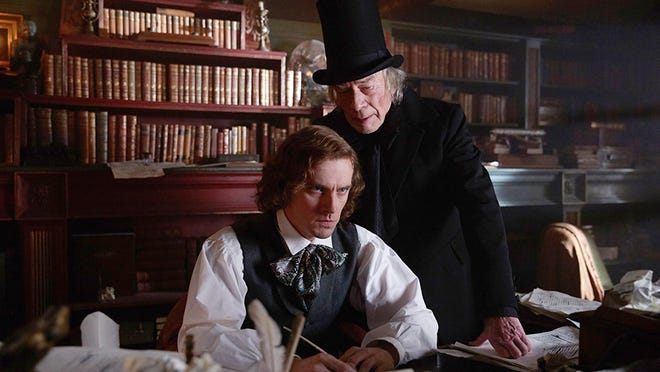 """The Man Who Invented Christ­mas"" stars Dan Stevens, left, and Christopher Plummer."