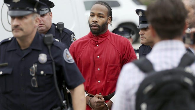 Jonathan Harris, who is accused of killing model Christina Carlin-Kraft in her home in August, is escorted into Magisterial District Court for a hearing on Friday, Oct. 5, 2018, in Ardmore, Pa. Harris said that he went to Carlin-Kraft's apartment in an affluent Philadelphia suburb to sell her cocaine but that she refused to pay, and that a violent fight ensued, according to a statement read in court Friday. (Tim Tai/The Philadelphia Inquirer via AP)