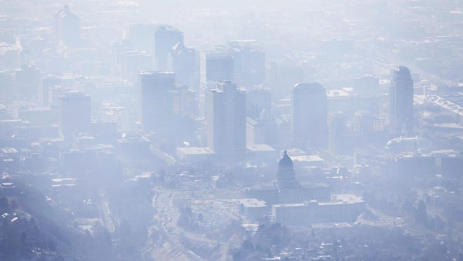 Smog covers Salt Lake City as an inversion lingers.