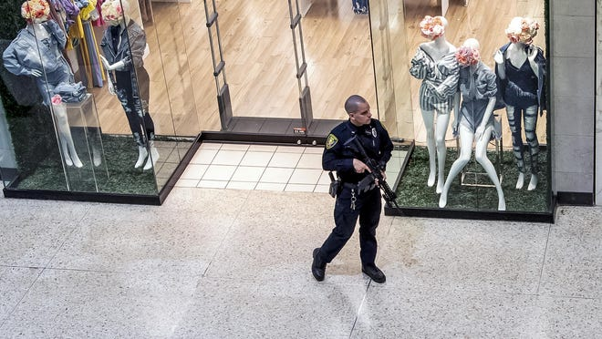 Responding to a call of shots fired, a Monroeville Police officer patrols the Monroeville Mall, Friday, April 12, 2019, in Monroeville, Pa. (Alexandra Wimley/Pittsburgh Post-Gazette via AP)