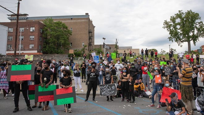Hundreds of protesters gather outside of the Newburgh City Police headquarters Tuesday.