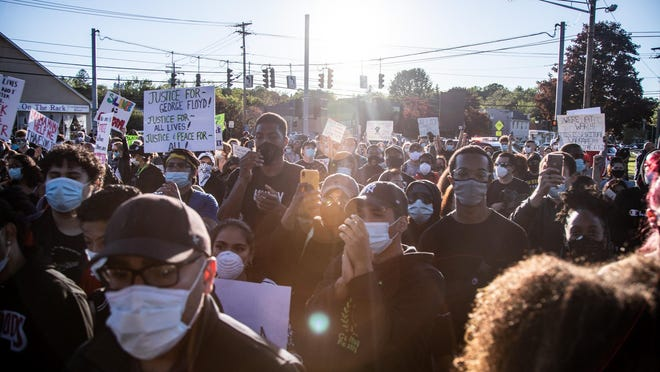 Hundreds of Black Lives Matter protesters march around Mill Pond in Monroe on Sunday.
