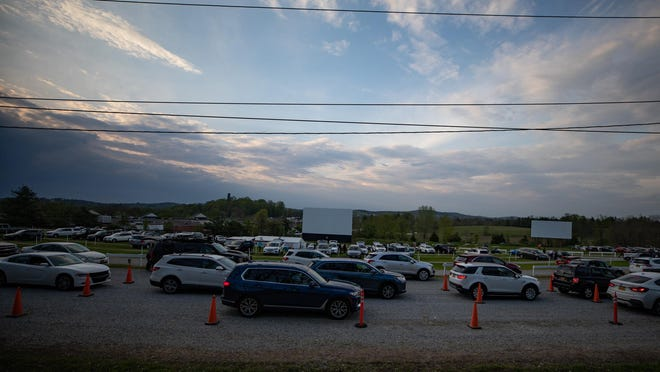 Moviegoers line up to get their tickets Friday at the Warwick Drive-In.
