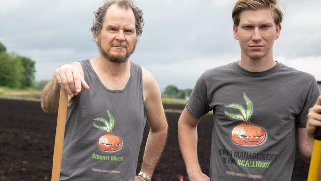 Chris Pawelski, left, and his son Caleb show off their Ornery Onion Company T-shirts on their farm in Goshen.  The Pawelskis are using the T-shirts as a vehicle for them to learn the ins and outs of direct marketing – and assess the potential for selling onions and other vegetables online.