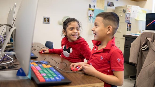 Ashlin Perez Sanches, left, and Eliezer Sorto Castro spend time in the computer room at Smith Clove Elementary in Central Valley.