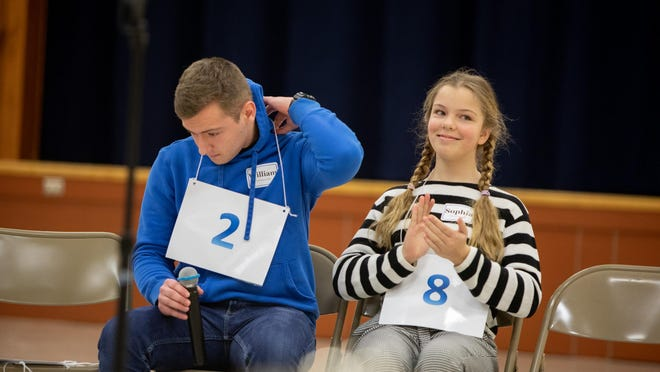 """Sophia Amchentsev, a seventh-grader at Valley Central Middle School, is all smiles after winning the Orange-Ulster BOCES Spelling Bee on Tuesday night. Runner-up William Mackin III, an eighth-grader at Port Jervis Middle School, removes his number after misspelling """"ungetatable."""""""