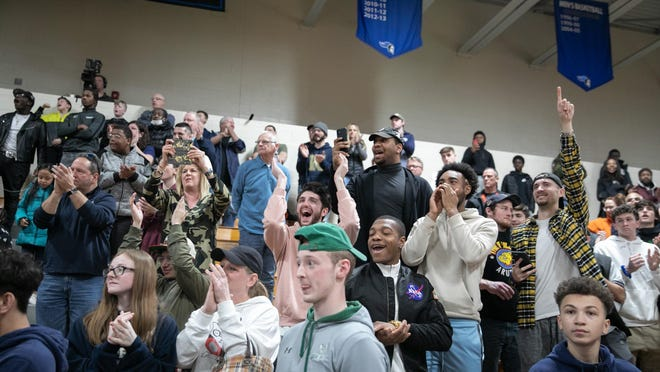 Newburgh fans cheer during the Section 9 Class AA boys basketball championship last week. No fans will be allowed to attend state playoff games due to the coronavirus.