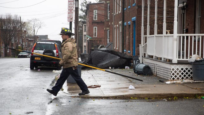 A Newburgh firefighter was on the job April 13, when high winds blew a roof off a building on Renwick Street.