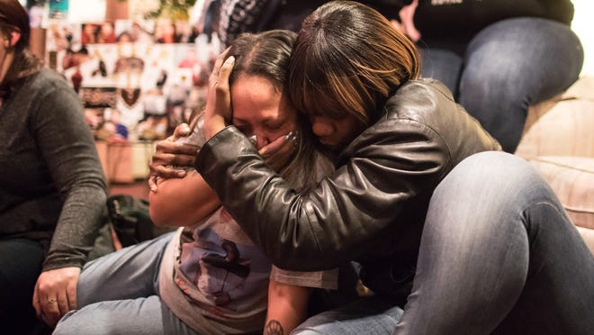 Emily Rivera, left, is comforted by her friend Terron Pierson at her nephew Roy M. Boyd's funeral on Wednesday in Middletown.