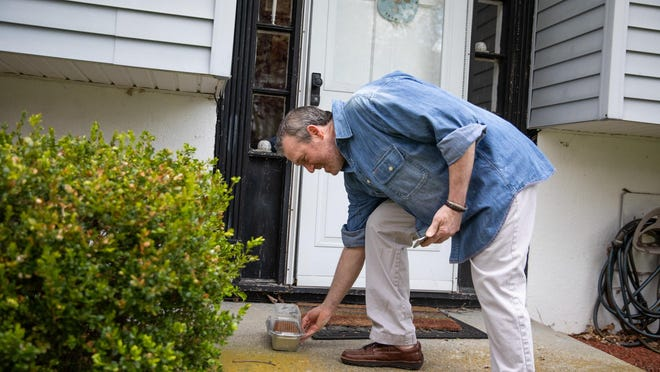 Chef Ken Katz delivers some banana bread to his neighbors in Chester.