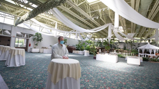 Bonura hospitality group owner Mike Bonura sits in an empty ballroom in Anthony's Pier 9, one of his catering venues in New Windsor on May 7.