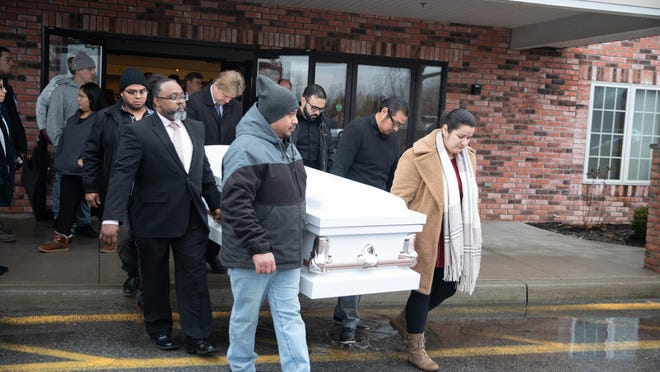 Loved ones carry out the caskets of Jimmy Crisantos, Shatavia Crisantos, and Giovanni Tambito at their funeral service Friday at the Crossroads Assembly of God Church in the Town of Newburgh. The three were fatally shot in their Town of Newburgh home on Jan. 26.