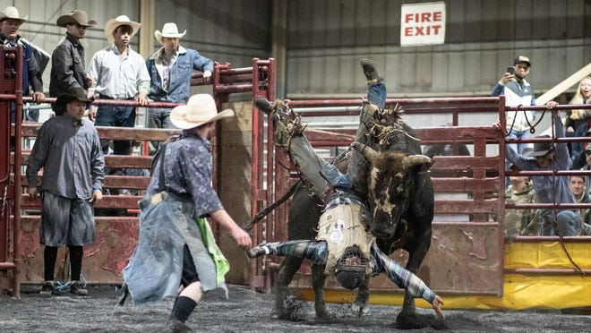 Bull riders compete in the Orange County Stampede indoor bull riding tournament on Sunday in Middletown.