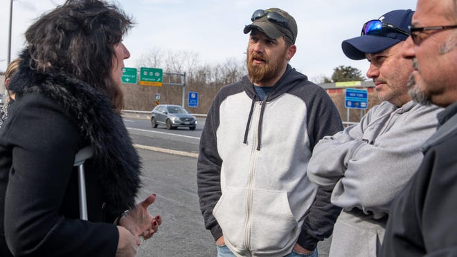 State Sen. Sue Serino, left, talks to bridge workers Brad Gardner, center, and Jeff Smith, right, after Thursday's rally in Highland against  Gov. Andrew Cuomo's plan to merge the Bridge Authority into the Thruway Authority.