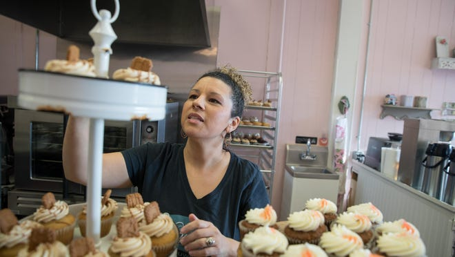 Nicole Conklin sets out cupcakes at her new store, Whipped Cupcakes Patisserie in Maybrook. {ALLYSE PULLIAM PHOTOS/For the Times-Herald Record}